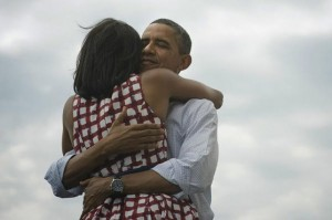 Obama's warm image, here seen hugging his wife, is an advantage in voters' minds